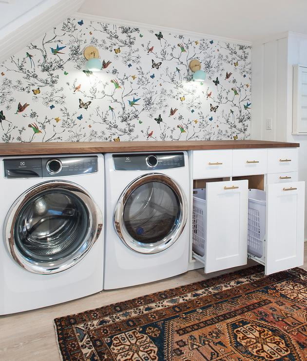 Basement Laundry Nook With Pull Out Hamper Cabinets