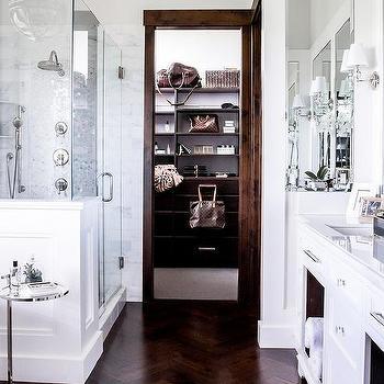 White Master Bathroom With Dark Wood Trim