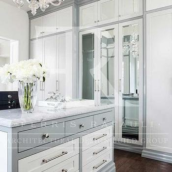 White And Gray Walk In Closet With Mirrored Doors