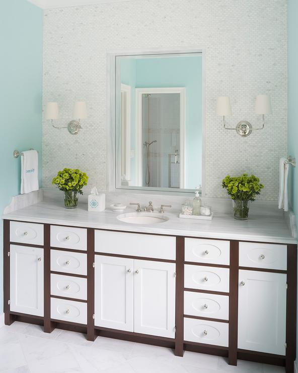 Girls Bathroom With Sky Blue Walls And Oval Marble Tiles