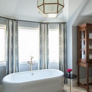 Oval Wainscoted Bathtub With Marble Deck Transitional Bathroom