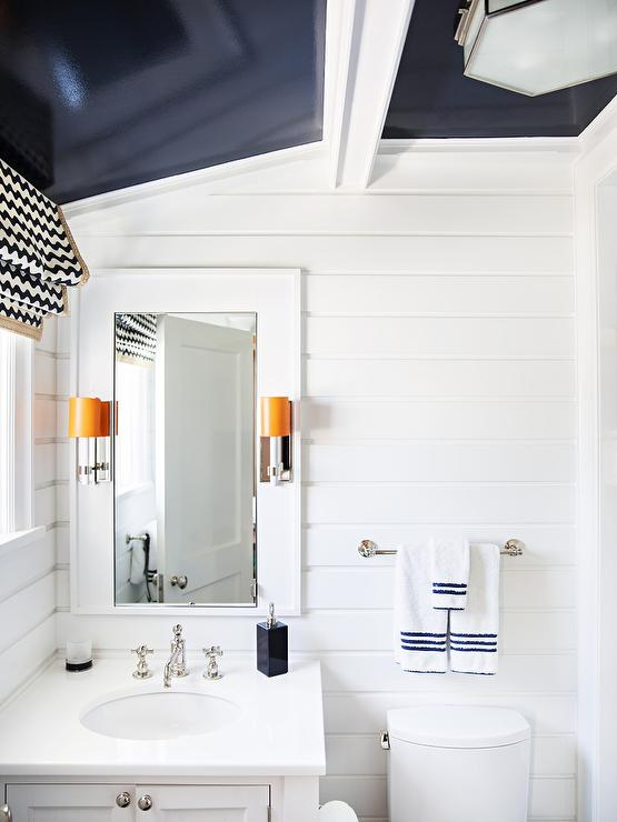 White kid bathroom with navy blue glossy ceiling Navy blue and white bathroom