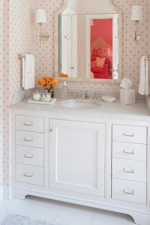 white girl bathroom with pink polka dot wallpaper - transitional