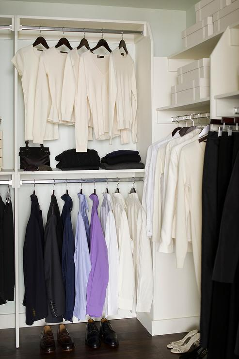 White Modular Closet With Clothes Organized By Color