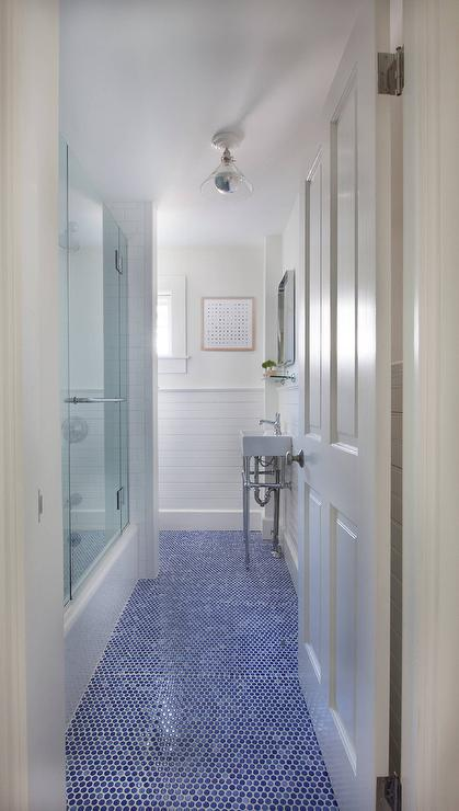long white bathroom with blue hexagon tile floor transitional