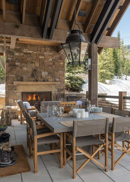 Rustic Cabin Covered Patio With Square Concrete Dining Table