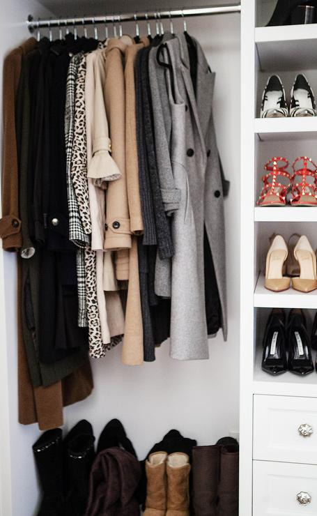 Boots Sit Under Winter Coats Hung From A Clothing Rail Fixed Beside Built In Shoe Shelves Positioned Above White Dresser Adorning Polished Nickel