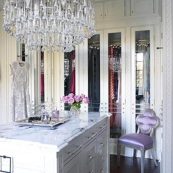 Glamorous Walk In Closet With Tiered Crystal Chandelier