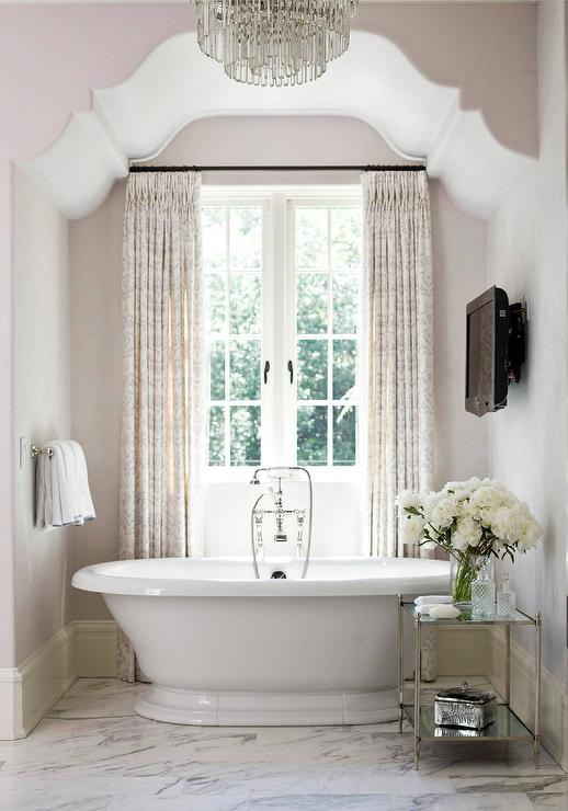 Pink Bathroom With Bathtub Facing Wall TV