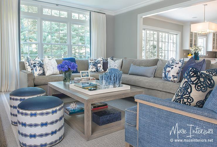 blue and gray living room features a gray velvet sectional lined with