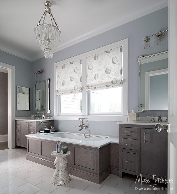 Chandelier Over Bathtub: Light Gray Oval Wainscoted Tub Under Light Gray Plantation