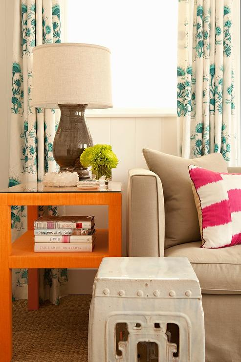 Delightful Gray Sofa With ORange End Table