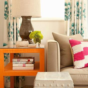 Gray Sofa With ORange End Table