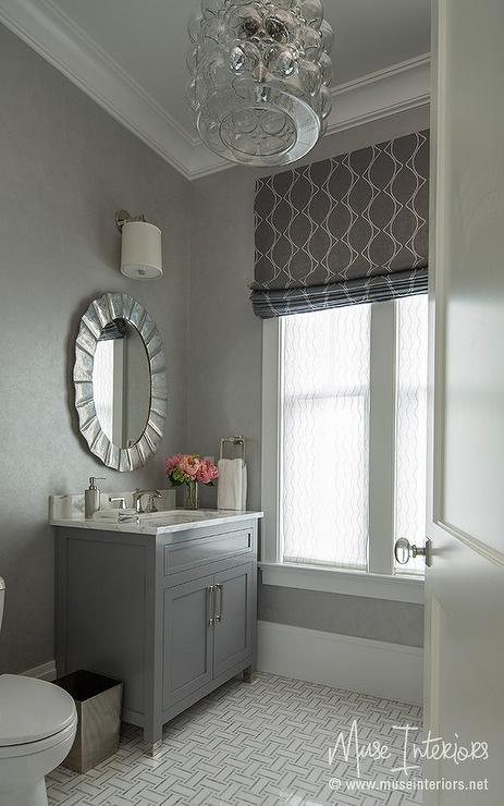Gray Powder Room With Oval Silver Leaf Mirror