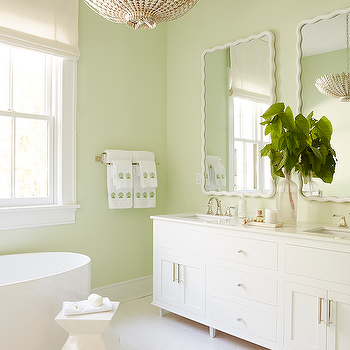 White Bathroom With Green Accents And Marble Herringbone