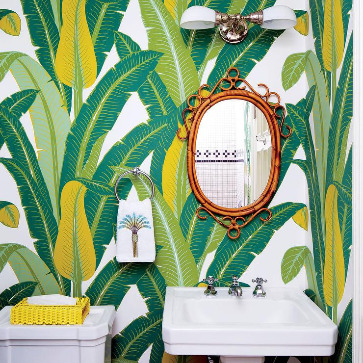 Schumacher Tropical Isle Wallpaper Covers The Wall Of This Gorgeous Yellow  And Green Powder Room Boasting An Oval Rattan Mirror Mounted Beside A  Polished ...