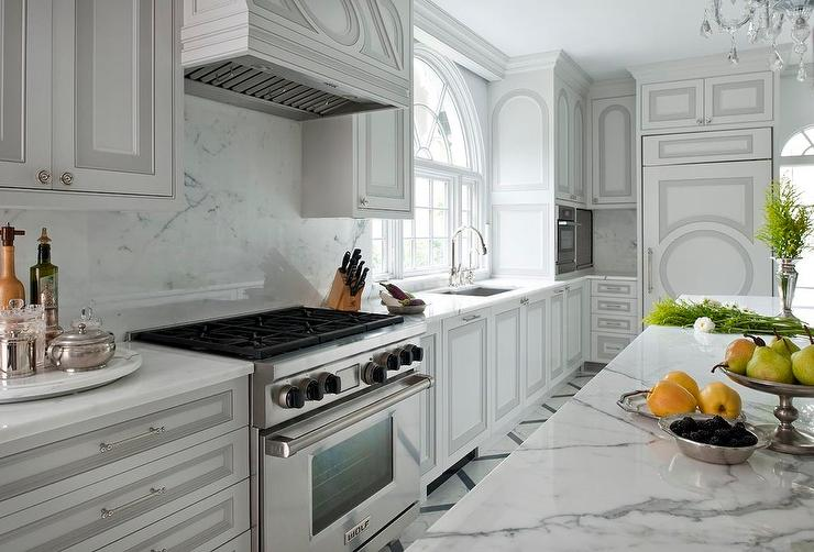 White Kitchen Cabinets With Gray Panel Doors Transitional Kitchen