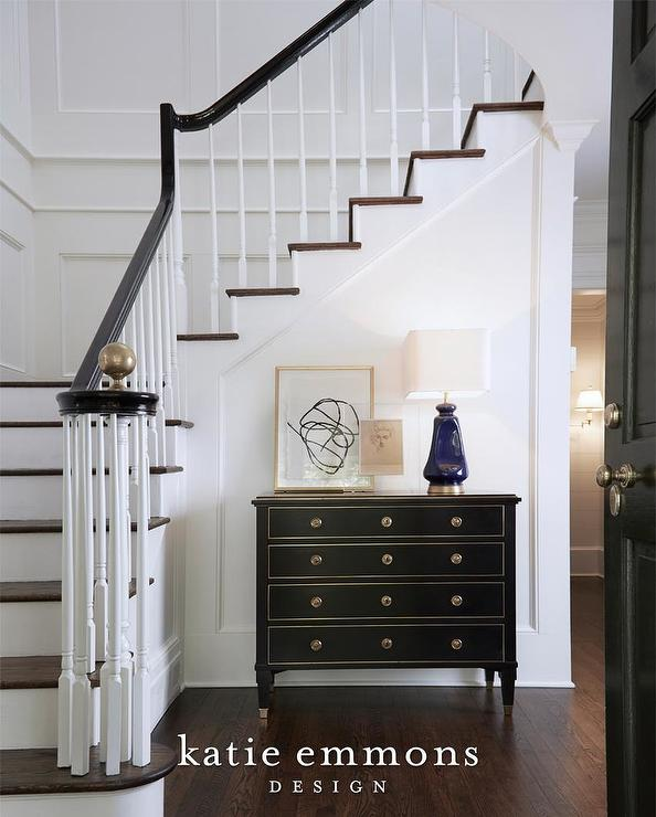 Gold And Black Chest With Blue Lamp On Staircase Wall