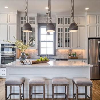 Dark blue center island with white quartz countertop for White and grey kitchen designs