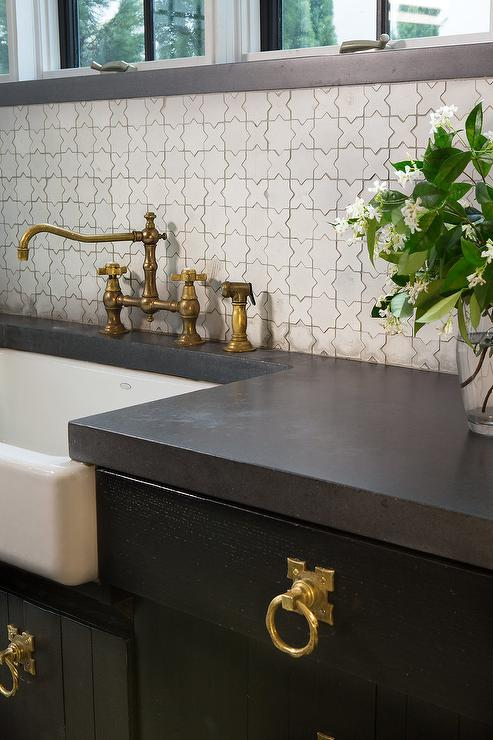 vintage style faucet paired with a white mosaic tiled backsplash