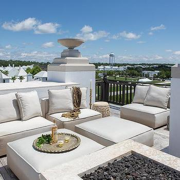 Cream Outdoor Armless Chairs With Ottomans As Coffee Tables