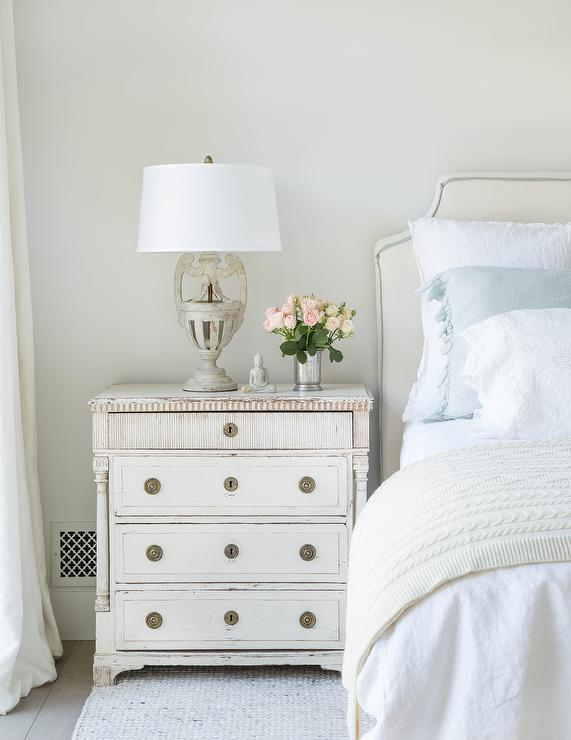 Off White Bedroom With Blue Ruffled Shams