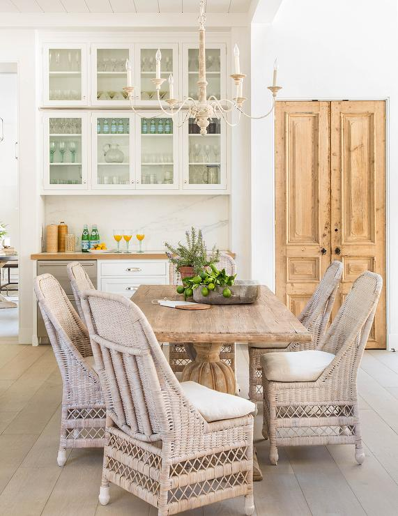 French dining nook in butler pantry and mullion cabinets for Dining room table with wicker chairs