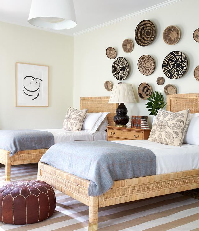 Twin Rattan Beds With Decorative Wall Baskets Eclectic