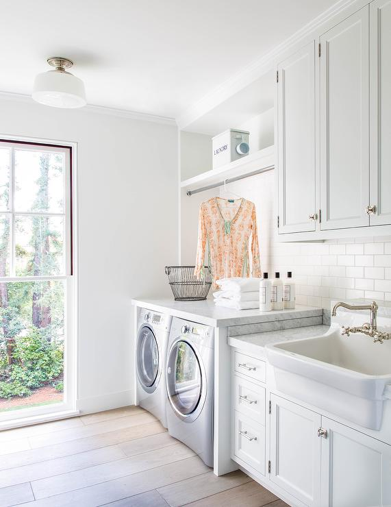 White Laundry Room With Apron Sink And Gray Wash Wood Floors