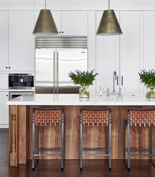 Goodman Hanging Lamps Are Hung Above A Long Stained Oak Island Adorning A  Polished White Marble Countertop Fitted With A Polished Nickel Deck Mount  Faucet ...
