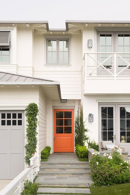 White Home With Orange Front Door Transitional Home Exterior