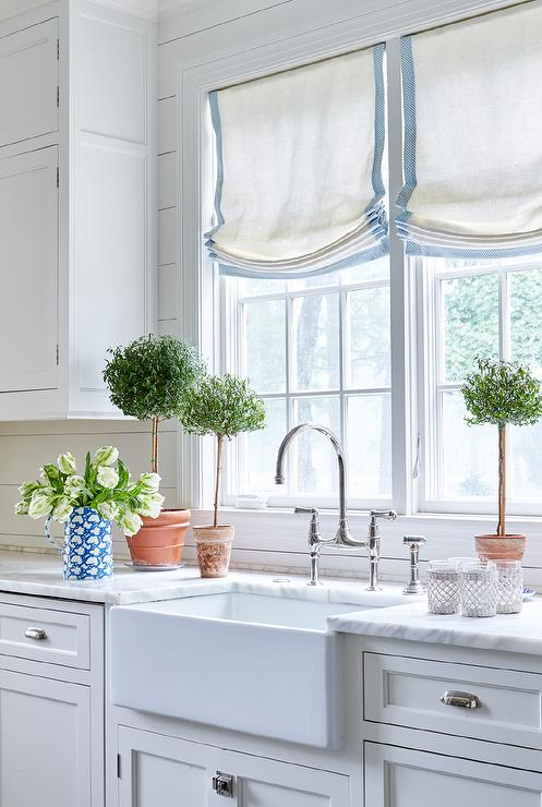 White Kitchen Peninsula With Backless Blue Bistro Stools