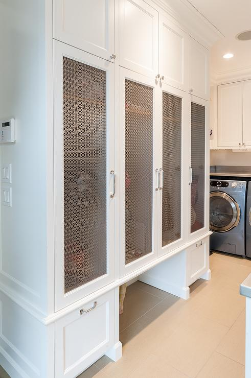 gorgeous laundry room and mudroom combo is equipped with metal grill