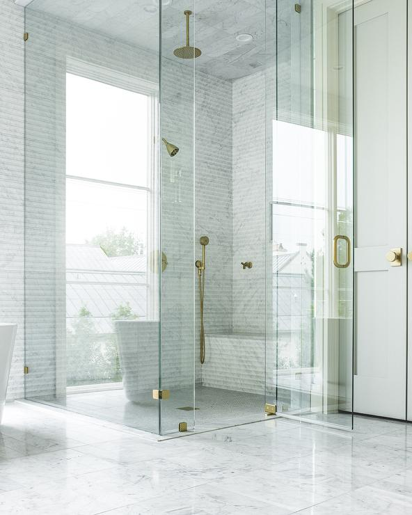 Gray And Gold Shower Design With Carrera Marble Tiles