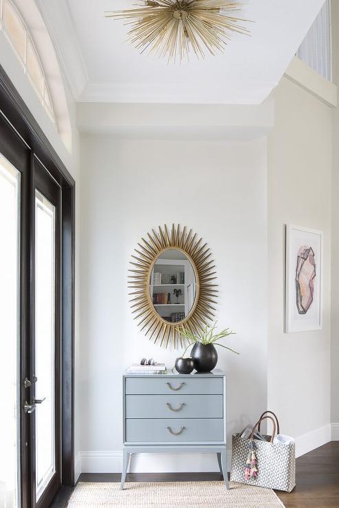 Oval Foyer Mirror : Gold oval mirror over gray credenza cabinet contemporary