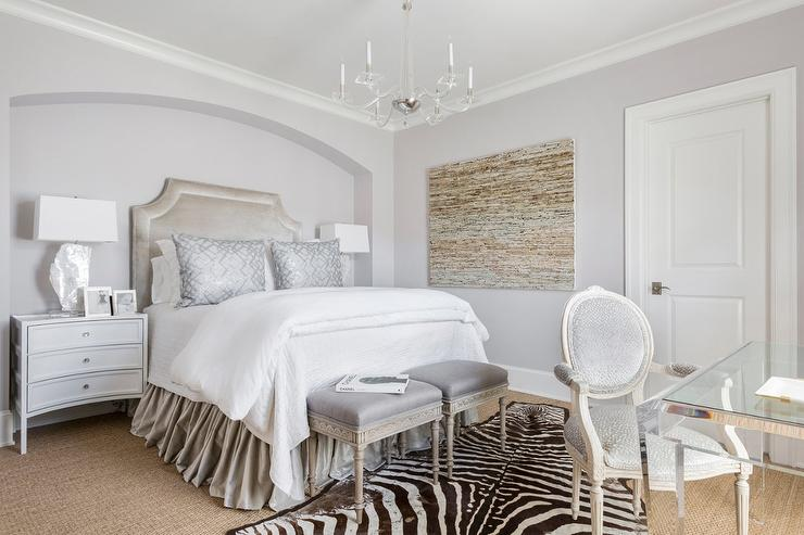 Bedroom With Gray Walls And A White Arched Tufted Bed
