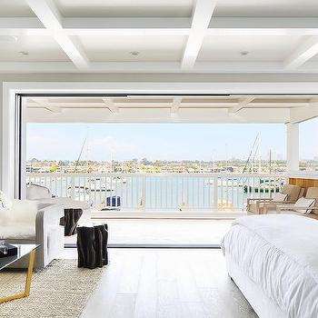 Beachside Master Bedroom with Folding Doors to Balcony. Bedroom Balcony Design Ideas