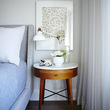 Wonderful Heather Gray Upholstered Bed With Round Marble Top Nightstand