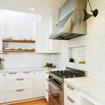 Skylight Over Floating Wood Kitchen Shelves