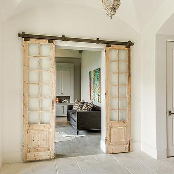 Home Office With Distressed Sliding Doors On Rails