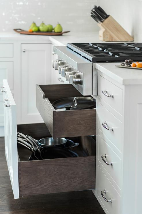 pot and pan drawers under stainless steel stove