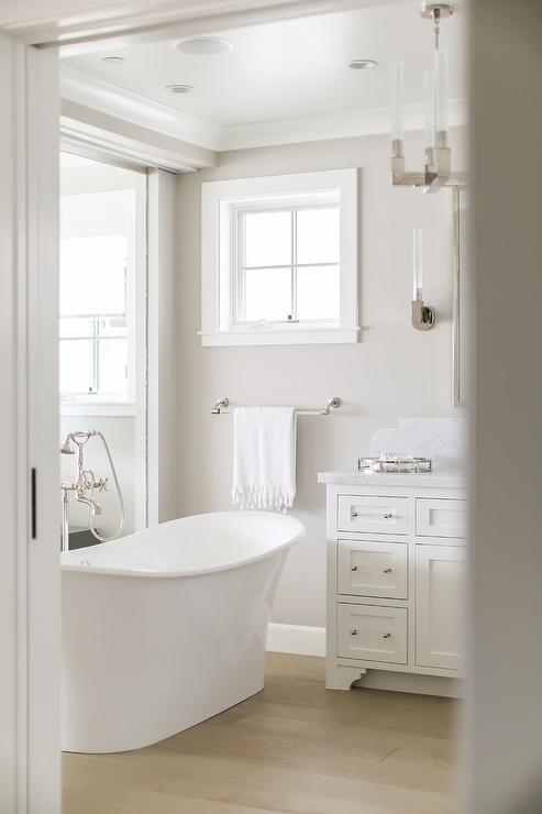 Victoria And Albert Bathtub With Gray Wash Wood Floors