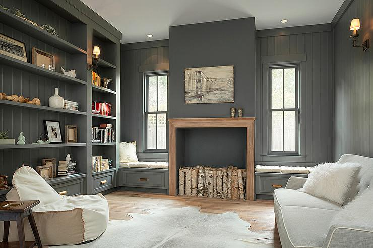 Chic Gray Den Is Equipped With A Charcoal Faux Fireplace Complemented Wood Mantel And Birch Decor