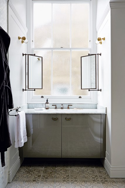 Gray And Gold Bathroom With Floating Concrete Sink