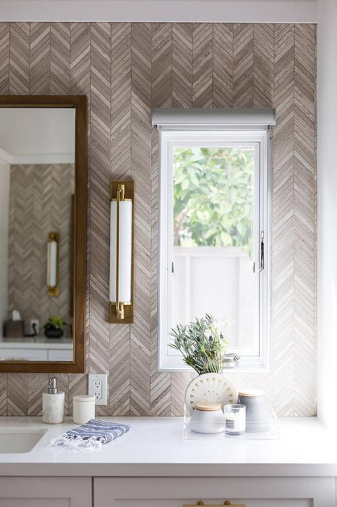 Gray And Gold Bathroom With Taupe Herringbone Tiles