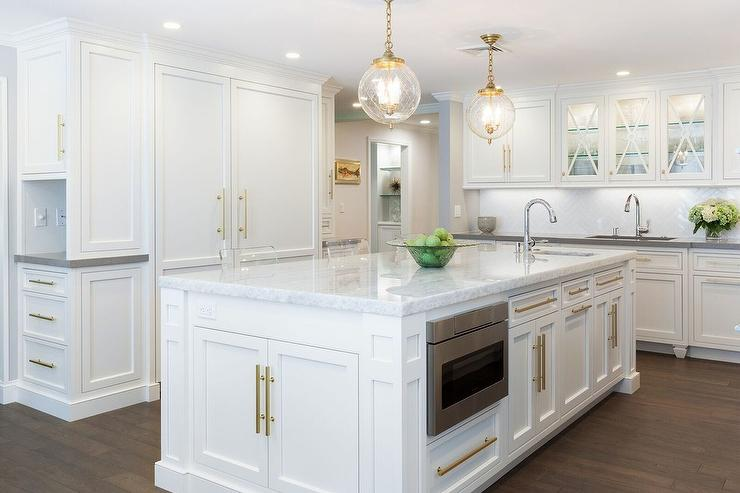 White Kitchen Island With Long Brass Pulls