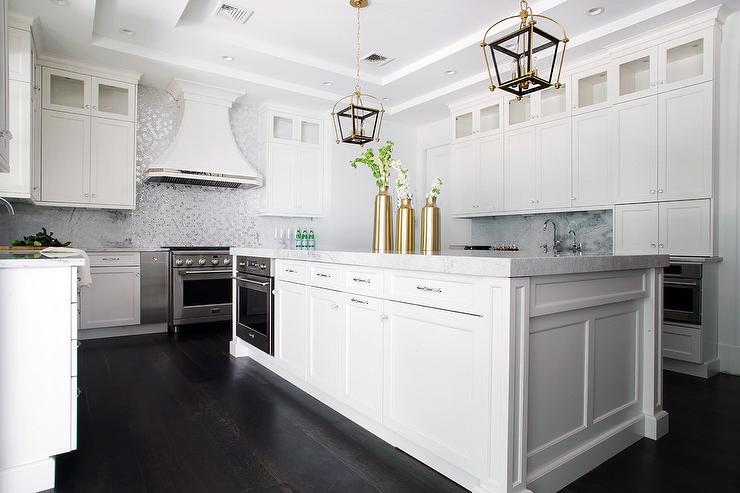 White Kitchen Island With Black And Gold Lanterns Transitional
