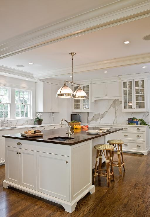 Black island with white ocuntertops design ideas for White kitchen cabinets with black island