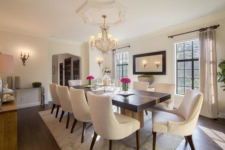 Black Dining Table with Cream Upholstered Dining Chairs ...