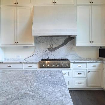 curved gray marble cooktop backsplash